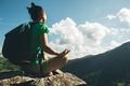Hiker meditation on mountain top - PhotoDune Item for Sale
