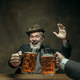 Smiling bearded male drinking beer in pub - PhotoDune Item for Sale