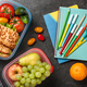Lunch boxes and school supplies on black - PhotoDune Item for Sale