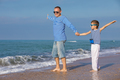 Father and son playing on the beach at the day time. Concept of - PhotoDune Item for Sale