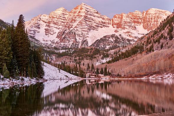 Maroon Bells and Maroon Lake at sunrise - Stock Photo - Images