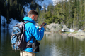 Backpacker taking photo with smartphone - PhotoDune Item for Sale