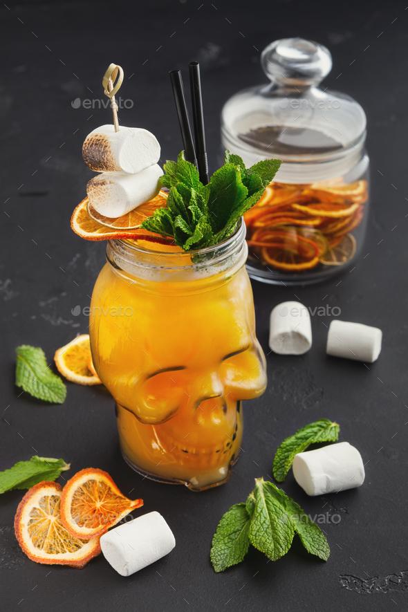 Orange cocktail in skull glass - Stock Photo - Images