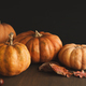 Beautiful pumpkins with leaves and chestnuts on black background - PhotoDune Item for Sale