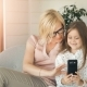 Mother Uses Phone with Daughter - VideoHive Item for Sale