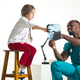 Young african male pediatrician explaining X-ray to child - PhotoDune Item for Sale