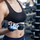 Strong women exercise in gym.She lifting dumbbells in right hand - PhotoDune Item for Sale