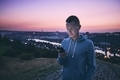 Man using phone at sunrise - PhotoDune Item for Sale