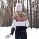 Cheerful Carefree Girl Runs Through the Winter Forest and Looks Back at the Camera - VideoHive Item for Sale