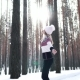 Girl in the Winter Forest Whirls and Rejoices the Rays of the Sun - VideoHive Item for Sale