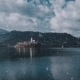 Aerial Video of a Bled Lake in Snowy Autumn Day with a Church in a Foreground - VideoHive Item for Sale