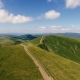 Aerial Shot of Carpathian Ranges with Country Roads with One Person in Summer - VideoHive Item for Sale