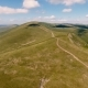 Aerial Shot of Carpathian Uplands with Curvy Lanes  and Cloud Shades in Summer - VideoHive Item for Sale