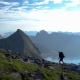Girl with a Backpack Rises on a Mountain Ridge - VideoHive Item for Sale