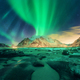 Aurora over snowy mountains. Northern lights - PhotoDune Item for Sale