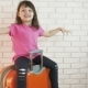 A Happy Child Is Sitting on the Luggage - VideoHive Item for Sale