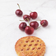 cherries and cookie on white marble - PhotoDune Item for Sale