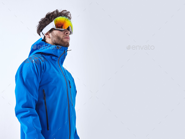The mountaineer in winter clothes and ski ultraviolet protected mask on white isolated background - Stock Photo - Images