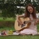 Beautiful Girl Playing Acoustic Guitar in Park. - VideoHive Item for Sale