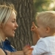Blonde Mom and Baby Laughing Outdoors - VideoHive Item for Sale