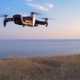 Quadrocopter Flies in Place Against the Background of the Sea - VideoHive Item for Sale