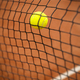 Tennis ball hitting the tennis net - PhotoDune Item for Sale