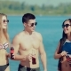 Portraits of Friends on the Beach, Who Clink Glasses of Soda and Drink Cola - VideoHive Item for Sale