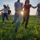 Group of Friends Running Happily Together in the Grass - VideoHive Item for Sale