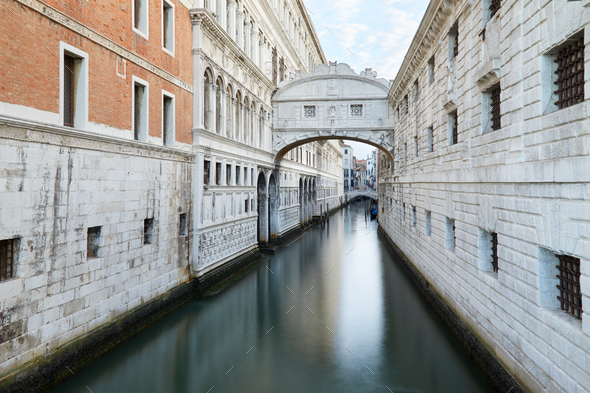 Bridge of Sighs and calm water in the canal, nobody in Venice - Stock Photo - Images