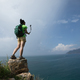 Hiker taking selfie on seaside cliff edge with action camera - PhotoDune Item for Sale