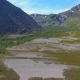 Aerial View of Mountain Valley and Waterfall Next To Road To Nordkapp, Norway - VideoHive Item for Sale