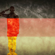 German grunge flag with soldier silhouette. - PhotoDune Item for Sale