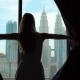 Superslowmotion Shot of a Silhouette of a Successful Rich Woman Opening the Curtains of a Window - VideoHive Item for Sale