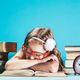 Little girl sleeping on an open book in funny red glasses - PhotoDune Item for Sale