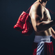 Red gloves hanging on the boxer's back. - PhotoDune Item for Sale