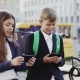 A Boy and a Girl Are Using a Smartphone and a Tablet - VideoHive Item for Sale