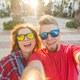 Travel, vacation and holiday concept - Funny couple in sunglasses having fun and taking selfie - PhotoDune Item for Sale
