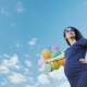 Happy Pregnant Woman Playing with Balloons Against the Blue Sky - VideoHive Item for Sale