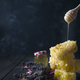 pouring honey into honey comb with lavender flowers on stone dark background - PhotoDune Item for Sale
