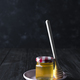 glass jar of honey and stick on a ceramic plate on a dark concrete background , copy space - PhotoDune Item for Sale