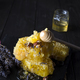pouring honey into honey comb with walnuts and lavender flowers on stone dark background - PhotoDune Item for Sale