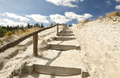stairs on sand to blue sky with clouds - PhotoDune Item for Sale