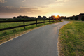 sunshine over cycling path by wooden fence - PhotoDune Item for Sale