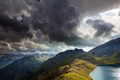 dramatic sky over alpine lake in mountains - PhotoDune Item for Sale