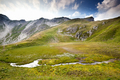 alpine river in mountains and blue sky - PhotoDune Item for Sale