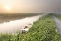 white boat on river during misty sunrise - PhotoDune Item for Sale