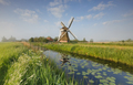 charming windmill by river over blue sky - PhotoDune Item for Sale