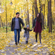 people, family and leisure concept - family with a young daughter walking in autumn park - PhotoDune Item for Sale