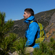 Backpacker hiker tourist in Rocky Mountains - PhotoDune Item for Sale