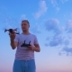 Quadrocopter Takes Off From the Hands of Men - VideoHive Item for Sale